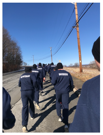 Officers jogging on a road